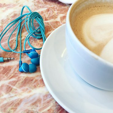 Headphones and cup of coffee