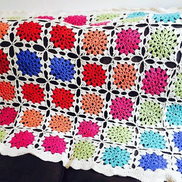 Crochet granny blanket on couch