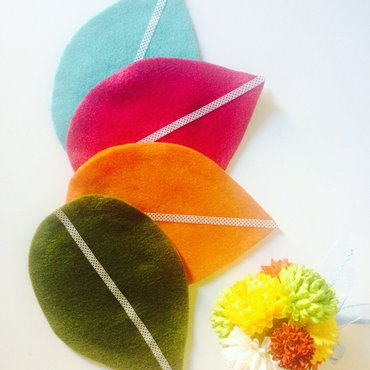 Set of four felt petal coasters