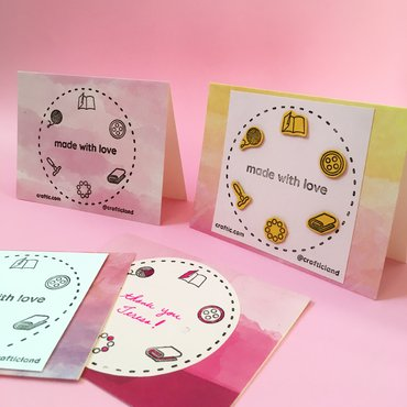 Four handmade stamped cards; two are standing and two are laying flat