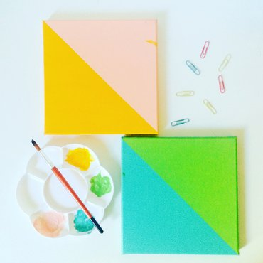 Two geometric paintings in teal & green and pink & orange