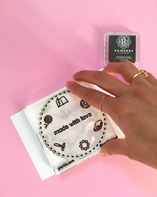 Hand stamping on white cardstock paper with acrylic clear stamp