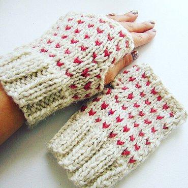 Knit hearts wristwarmer on pair of hands