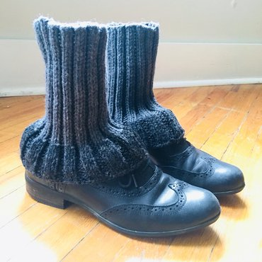 Knit legwarmers on pair of Oxford shoes