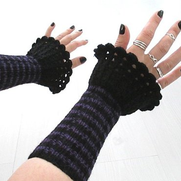 Pair of hands wearing ruffled and striped wristwarmers