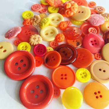 A bunch of yellow and orange buttons
