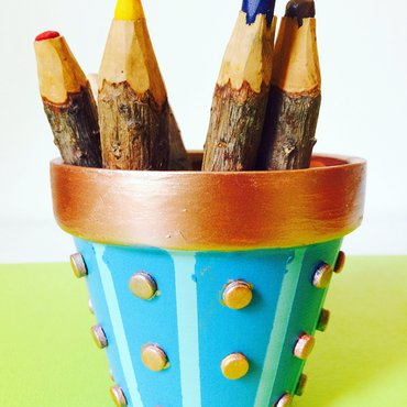 Painted Tardis inspired flower pot with coloring pencils