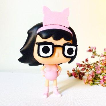 Tina Belcher funk pop wearing foam pink cat ears brooch