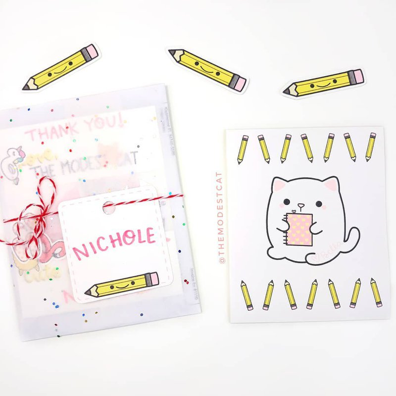 The Modest Cat - stickers and packaging