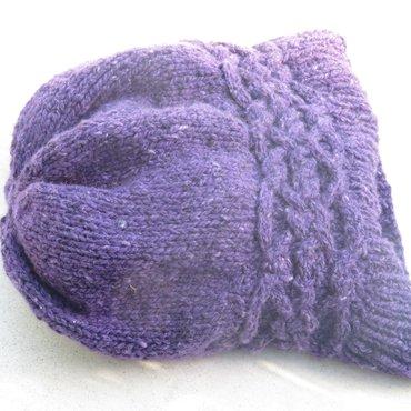 Knit purple tributary hat lying flat