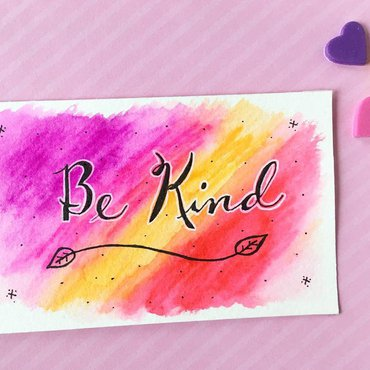 "Watercolor painted card with ""be kind"" hand lettered"